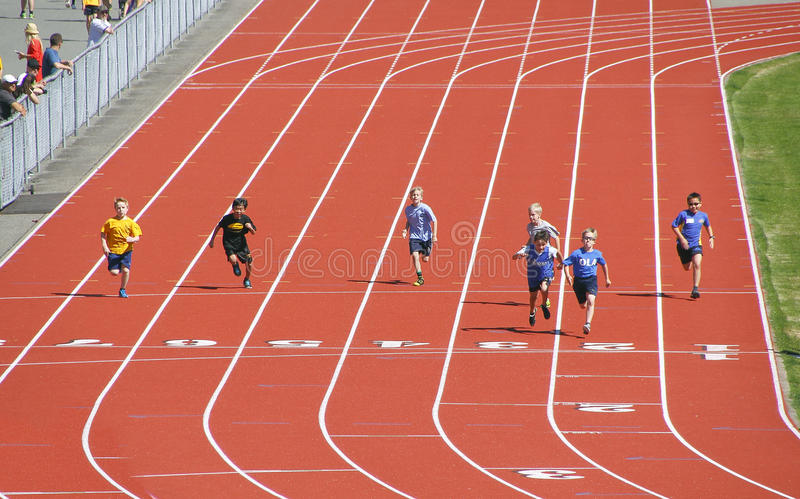 Children Compete in Track and Field stock images
