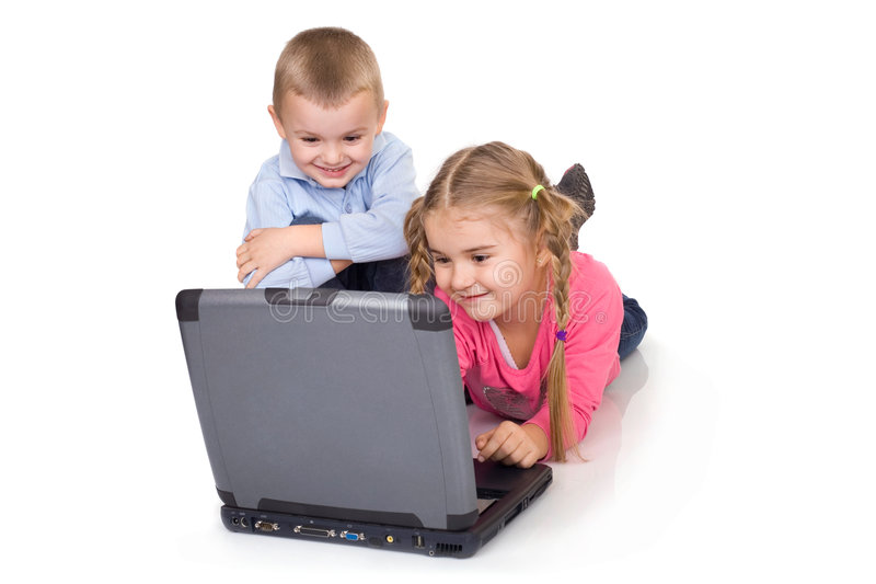 Children and computer. Kids playing computer games or surfing the Internet royalty free stock photos