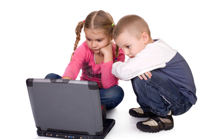 Children and computer. Children learnng or playing computer games stock photo