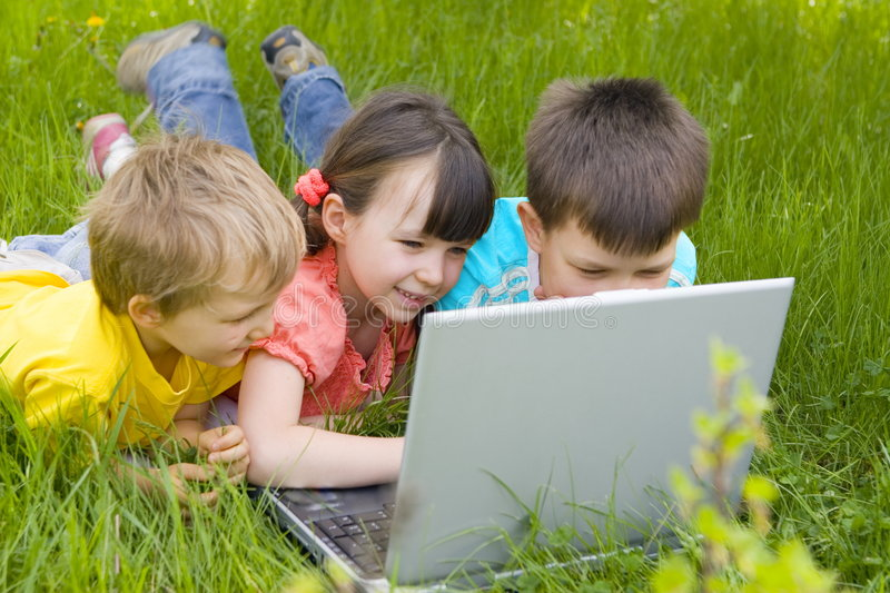 Children with computer royalty free stock photography