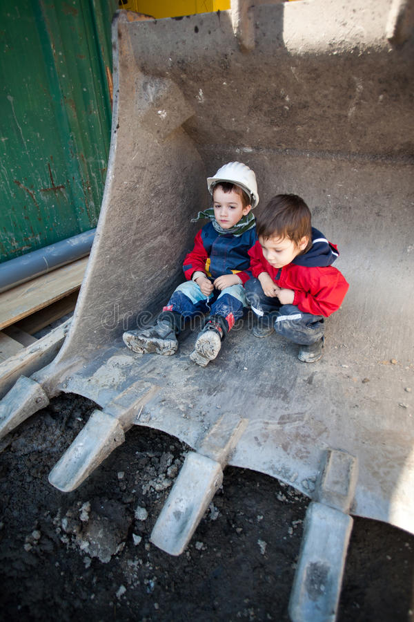 Children on construction site royalty free stock photography