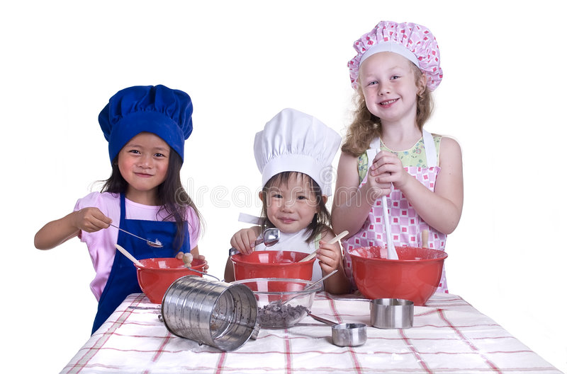 Children Cooking. A group of children cooking up something in the kitchen. Isolated on white stock photo