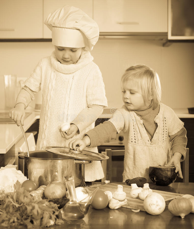 Children cooking in kitchen stock image
