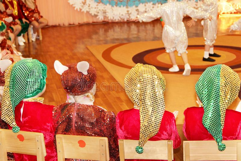 Children in costumes on morning performance dedicated to New Year in kindergarten stock photo