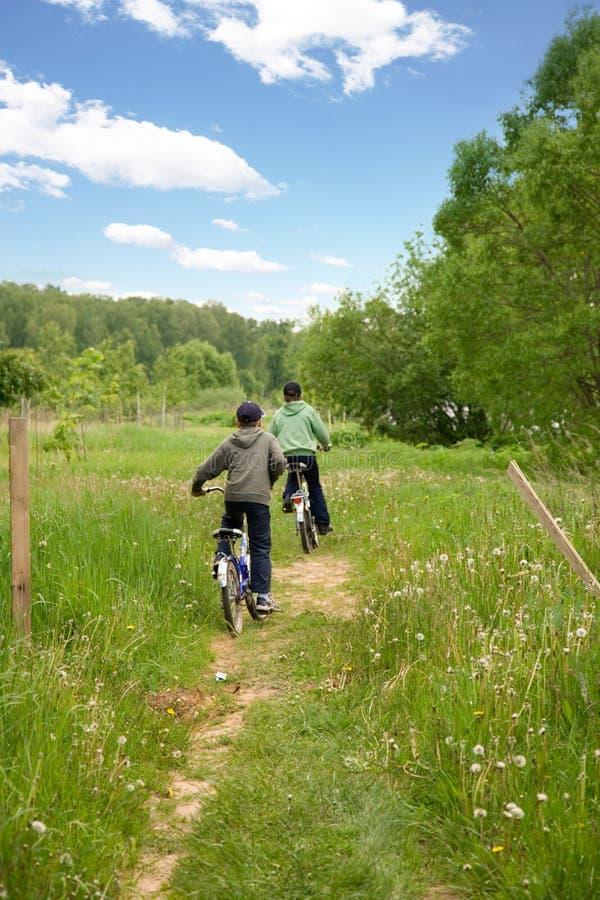 Children country biking stock photo
