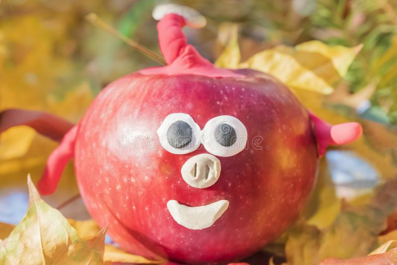 Children crafts pig from apple stock photography