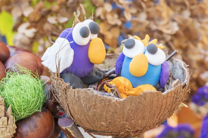 Children crafts - two birds in the nest royalty free stock image