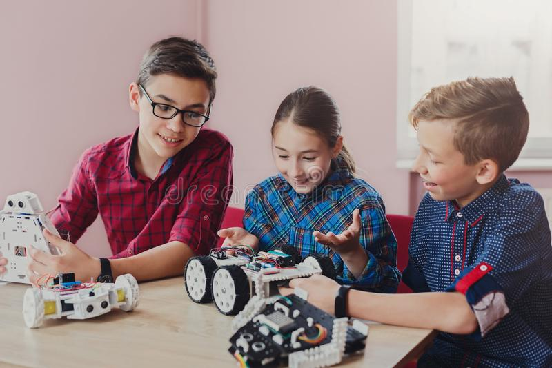 Stem education. Kids creating robots at school royalty free stock photo
