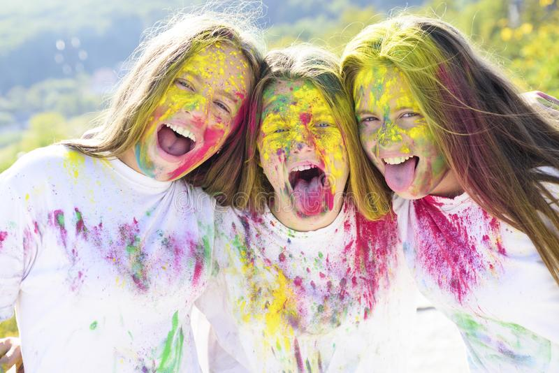 Children with creative body art. Crazy hipster girls. autumn weather. colorful neon paint makeup. Happy youth party royalty free stock images