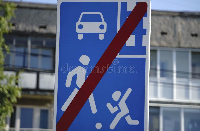 Children crossing the street in a school zone, road signs and road.  royalty free stock photo