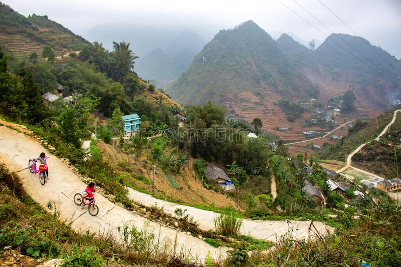Children cycling in the mountains stock image