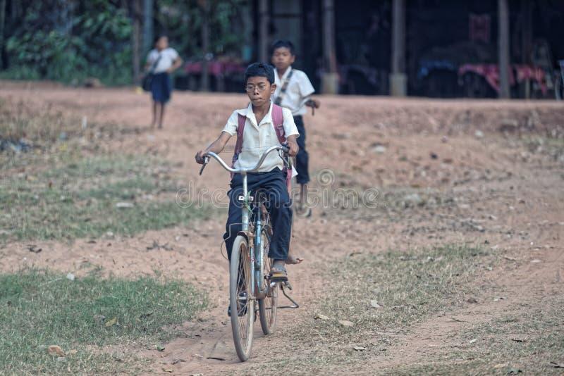 Children cycling near Bakong Temple stock photo