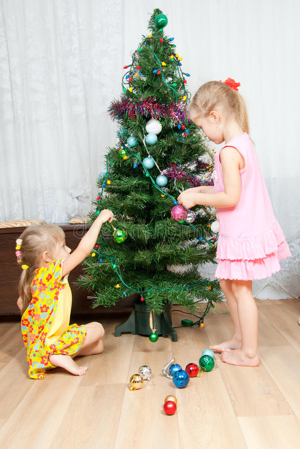 Download Children Decorate The Christmas Tree Royalty Free Stock Image - Image: 21809466