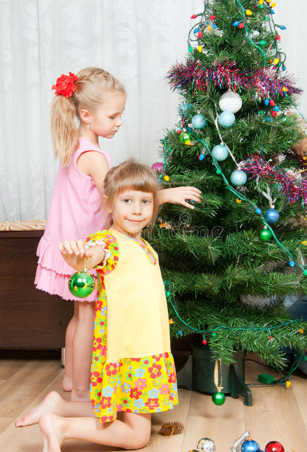 Download Children Decorate The Christmas Tree Stock Images - Image: 21809484