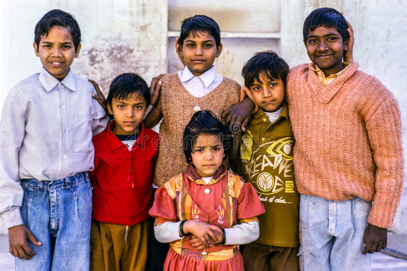 Children in Delhi, India. A group of six young children in a street in old Delhi, India stock photo