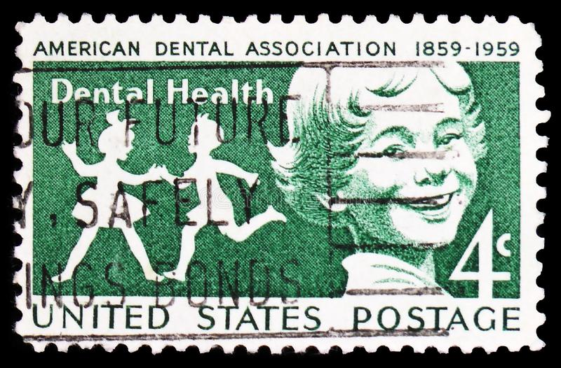 Children, Dental Health Issue serie, circa 1959. MOSCOW, RUSSIA - FEBRUARY 22, 2019: A stamp printed in United States shows Children, Dental Health Issue serie royalty free stock photo
