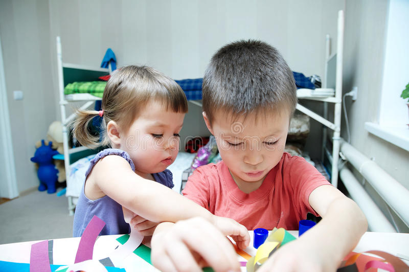 Download Children Development - Brother And Sister Playing Together Stock Photo - Image: 83720148