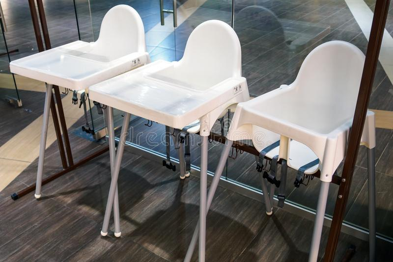 Children dining chairs in cafe, high chairs for baby stock image