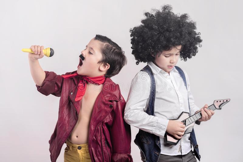 Rock stars. Children disguised as rock stars royalty free stock photo