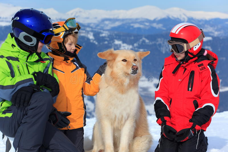 Children with dog in Alps royalty free stock photo