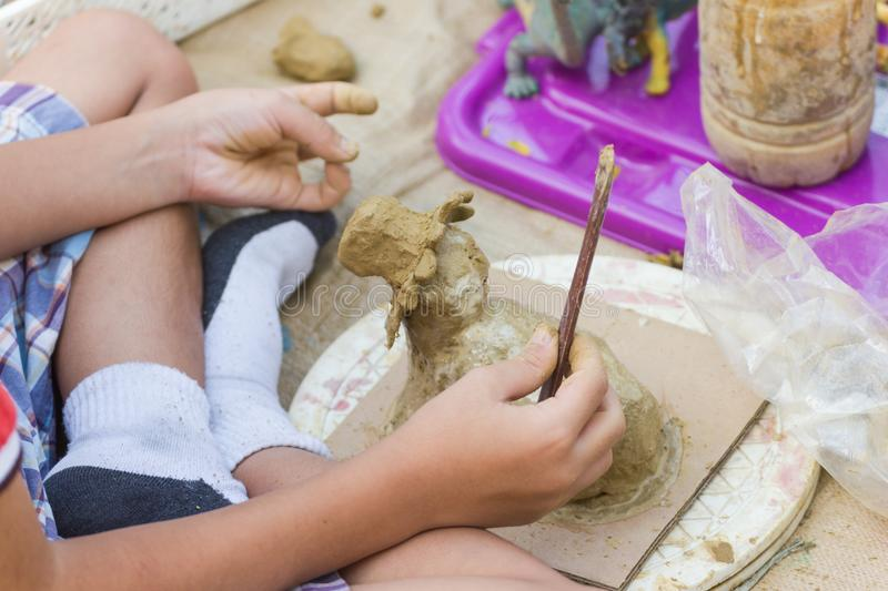 Children are doing activities clay play. Practice the skills at home vacation Bangkok Thailand royalty free stock photo
