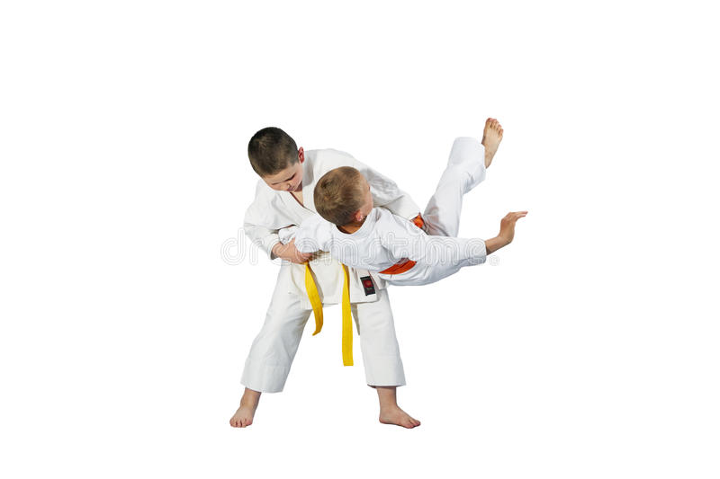 Children are doing high throws judo in judogi stock image
