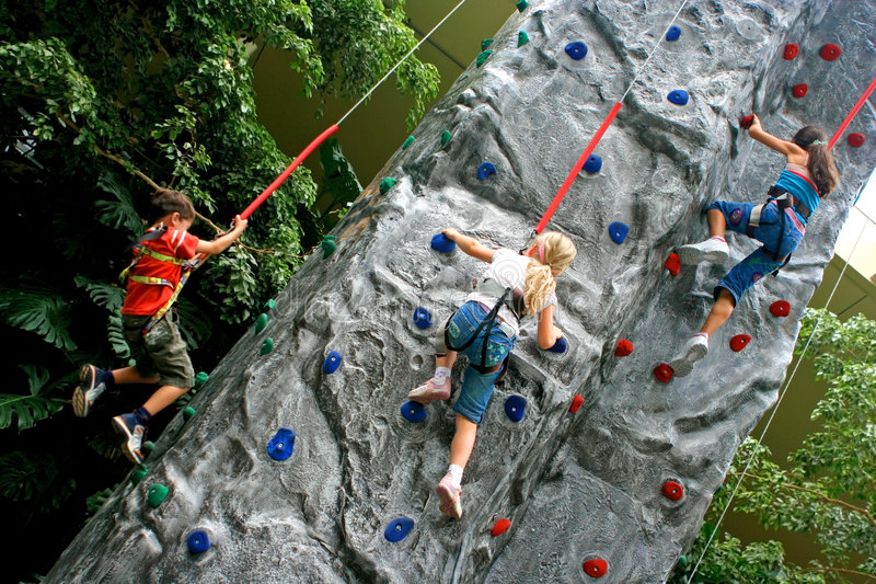 Children doing rockclimbing stock image