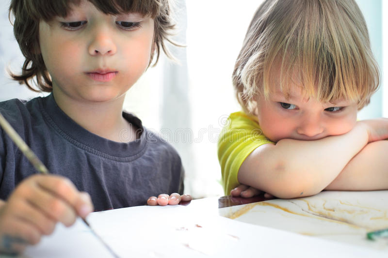 Children draw in home. Two happy children draw in home stock photo