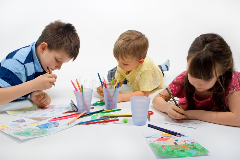 Children Drawing. One girl and two boys drawing pictures. Isolated on white background