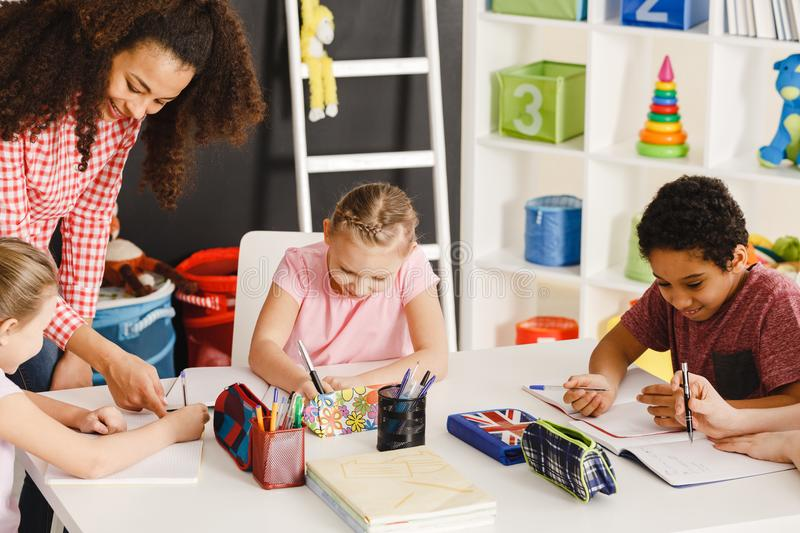 Children drawing during art class royalty free stock photography