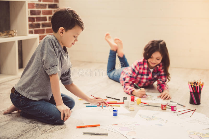 Children drawing at home stock images