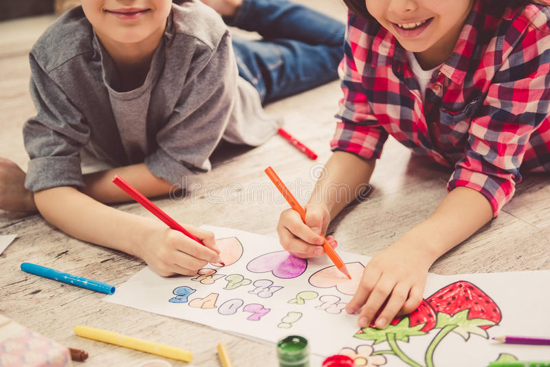 Children drawing at home stock image