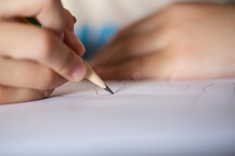 Children drawing with a pencil stock images