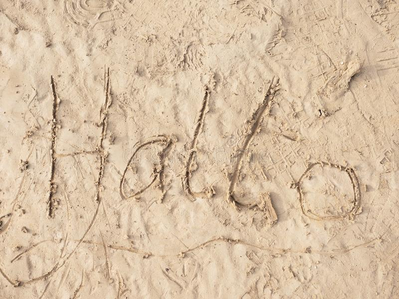 Children drawing of word hallo in sand on beach of bay. Letters written in sand. Children drawing of word hallo in sand on beach of bay. Letters written in wet stock photos