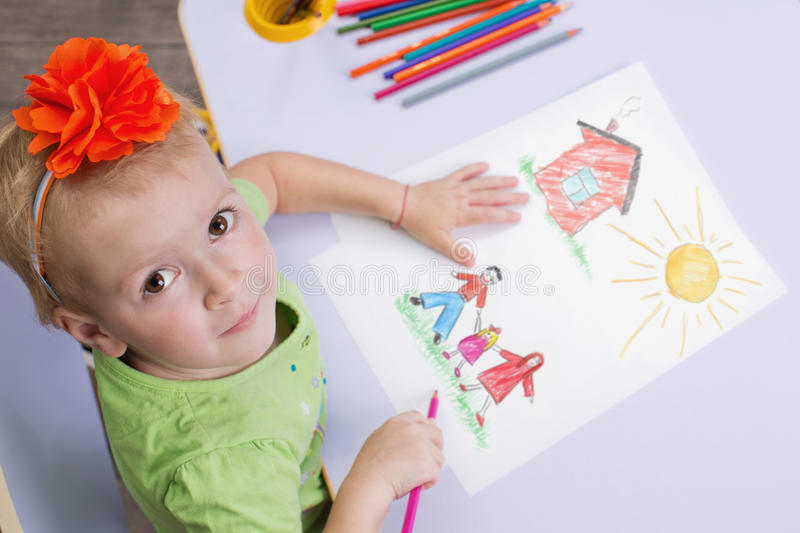 Children drawings. Cute child draw with colorful crayons stock photography