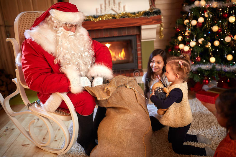 Children eagerly waiting gift from Santa Claus. Sack royalty free stock photo
