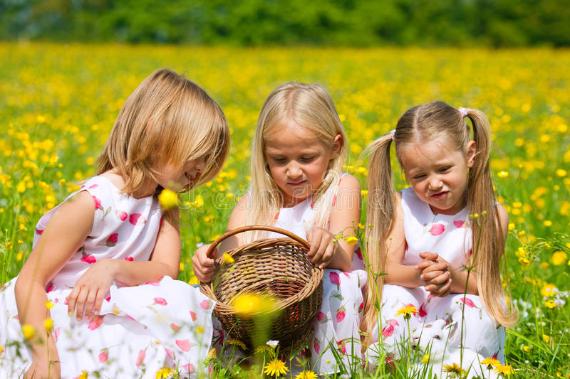 Download Children On Easter Egg Hunt With Eggs Stock Photo - Image: 18127216