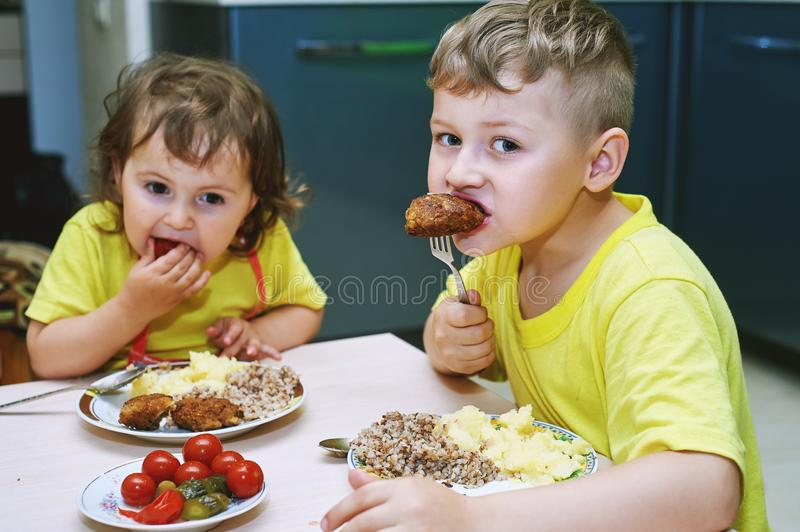 Kids at home eating homemade food. Children eat at home . Healthy homemade food stock image