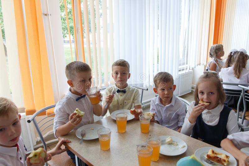 Children eat a treat at their first Breakfast royalty free stock images