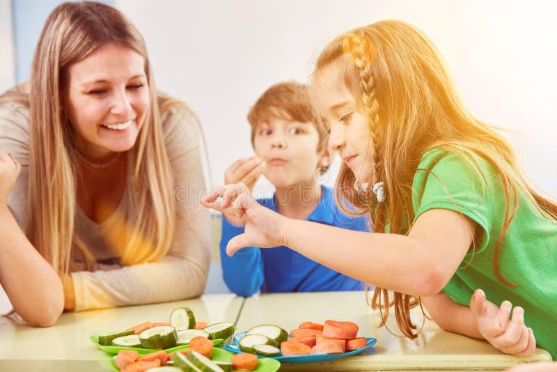Children eat vegetables as a snack in break of school royalty free stock photos