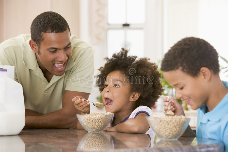 Children Eating Breakfast With Dad royalty free stock photography