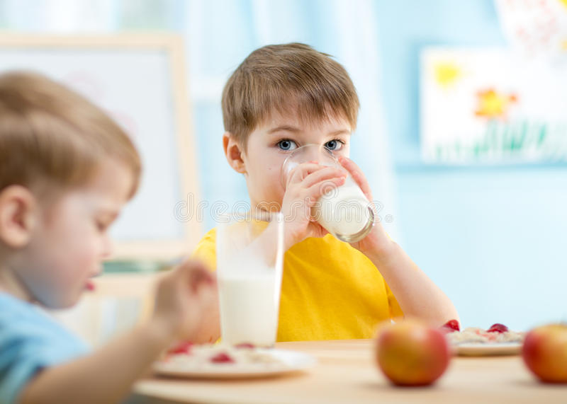 Children eating healthy food at home. Or kindergarten royalty free stock image