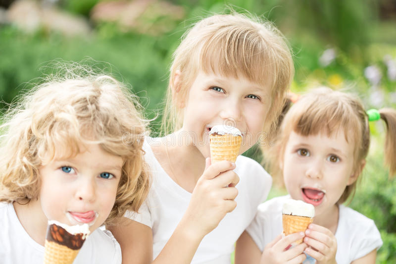 Children eating ice-cream royalty free stock photos