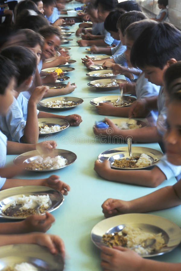 Children eating in refectory, Brazil. Children eating in the refectory of a school in Brazil stock photos