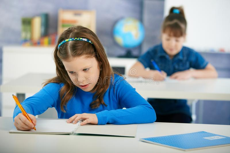Children in elementary school classroom stock photos