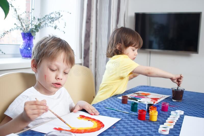 Happy Cheerful Child Drawing With Brush, In Home Interior ...