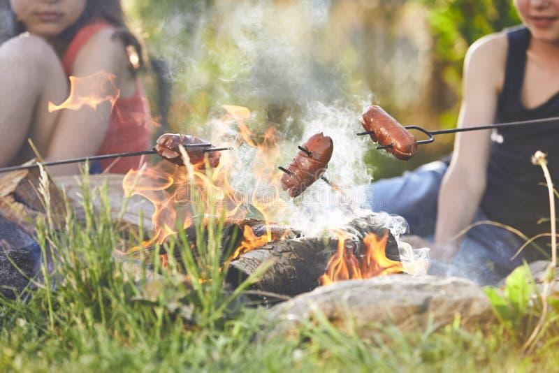 Children enjoy campfire stock photo
