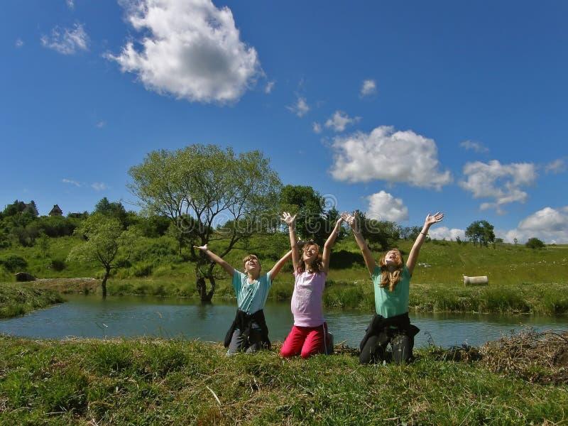 Children enjoy the spring stock image