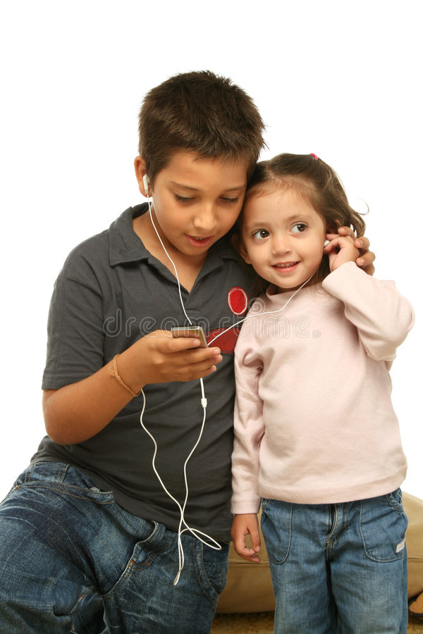 Download Children Enjoying A Mp4 Player Stock Image - Image: 2139741