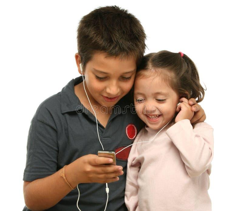 Download Children Enjoying A Mp4 Player Stock Image - Image: 2139761